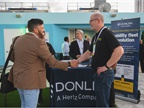 Paul Gillmore of Slick Technologies shakes hands with John Korte,