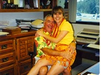 Enjoying Hawaiian dress day, Ed  snuggles  with Bobit Accounting